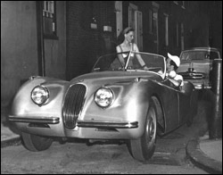 My parents and the silver Jaguar they were about to sell because my mother was pregnant with me and they needed the money